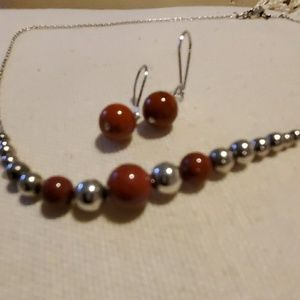 Silver and coral beaded necklace with earrings